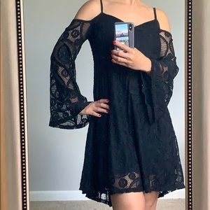 All lace black dress with bell sleeves
